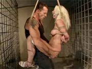 Blonde in cage torture