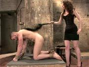 Dominatrix teases slave cock