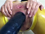 Latex girl gets huge dildo insertion