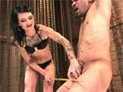 Simone Cross torturing cock