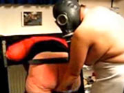 Spanking in gas mask