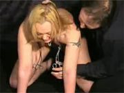 Blonde slut with clamped nipples
